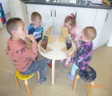 Four children brushing their teeth.