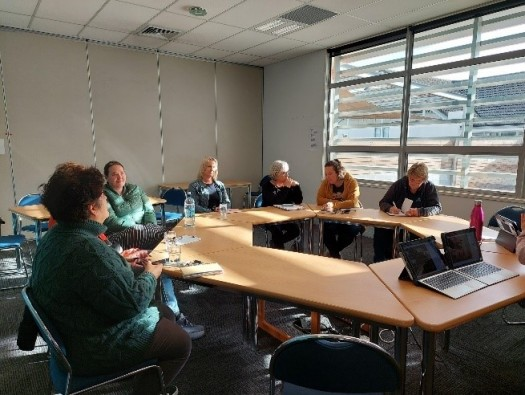 Attendees of regional workshop sit around a table