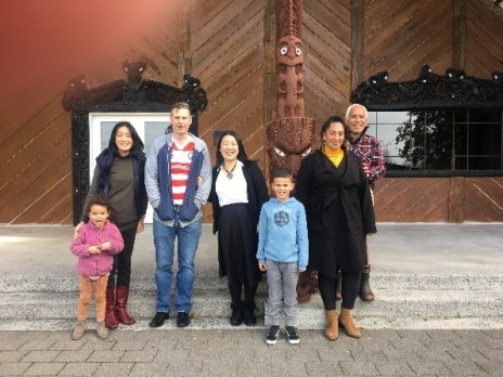 Japanese playgroup pose in front of Marae