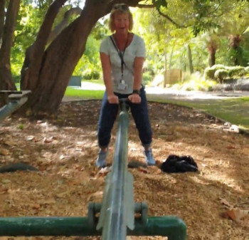 Adult on a seesaw